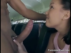 Asian schoolgirl bimbo sucks on the bus