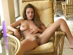 Busty pornstar Andrea drills her cunt with a dildo