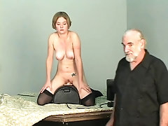 Short-haired b-cup golden-haired lowers her vagina onto mechanical sex toy
