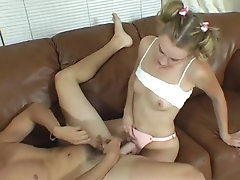 Teenage couple enjoys playing with strapon