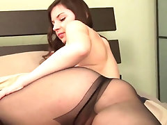 Busty teen shows her big butt in nylons